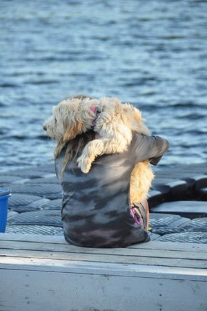 """Huggie"" - a hug between my daughter, Taylor, and our puppy Zoey, at<br /> Smugglers Island in the 1000 Islands, NY - one of our favorite<br /> family-owned vacation spots. - Brenda Abrams"