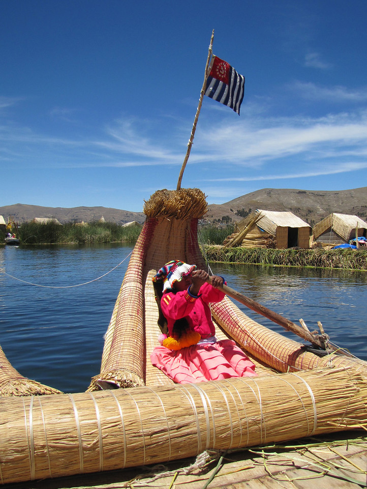 USPS Ensign proudly flies on a totora-reed boat. - William Bezdek